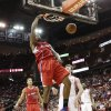 Los Angeles Clippers center DeAndre Jordan (6) dunks over Houston Rockets center Omer Asik during the first half of an NBA basketball game Saturday, March 30, 2013, in Houston. (AP Photo/Bob Levey)