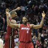 Miami Heat\'s LeBron James (6) and teammate Chris Bosh celebrate their victory over the Portland Trail Blazers during an NBA basketball game Sunday, Jan. 9, 2011, in Portland, Ore. The Heat defeated the Trail Blazers 107-100. (AP Photo/Rick Bowmer) ORG XMIT: ORRB108