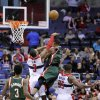 Washington Wizards shooting guard Bradley Beal, second from left, fouls Milwaukee Bucks point guard Monta Ellis, second from right, during the second half of an NBA basketball game on Friday, Nov. 9, 2012, in Washington. Beal was called for a flagrant foul on the play. Bucks guard Brandon Jennings, left, and Wizards forward Trevor Booker (35) looking on. The Bucks won 101-91. (AP Photo/Nick Wass)