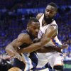 Oklahoma City Thunder guard James Harden, right, knocks the ball away from Memphis Grizzlies guard Tony Allen in the second quarter of Game 2 of a second-round NBA basketball playoff series in Oklahoma City, Tuesday, May 3, 2011. (AP Photo/Alonzo Adams)