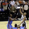 San Antonio\'s Tony Parker (9) puts up a shot over Oklahoma City\'s Kevin Durant (35) during Game 2 of the Western Conference Finals between the Oklahoma City Thunder and the San Antonio Spurs in the NBA playoffs at the AT&T Center in San Antonio, Texas, Tuesday, May 29, 2012. Oklahoma City lost 120-111. Photo by Bryan Terry, The Oklahoman