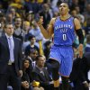 Oklahoma City\'s Russell Westbrook (0) celebrates in front of Memphis coach Dave Joerger after making a 3-pointer during Game 6 in the first round of the NBA playoffs between the Oklahoma City Thunder and the Memphis Grizzlies at FedExForum in Memphis, Tenn., Thursday, May 1, 2014. Oklahoma City won 104-84. Photo by Bryan Terry, The Oklahoman