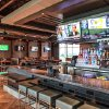 Photo - The bar at TopGolf at The Colony, Texas, is shown.
