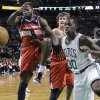 Photo -   Washington Wizards forward Martell Webster (9) and forward Jan Vesely, middle, battle with Boston Celtics forward Brandon Bass (30) for a rebound during the first half of an NBA basketball game in Boston, Wednesday, Nov. 7, 2012. (AP Photo/Elise Amendola)