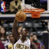 Indiana Pacers guard Lance Stephenson (1) dunks in front of Washington Wizards\' Garrett Temple, right, and Emeka Okafor during the first half of an NBA basketball game, Wednesday, Jan. 2, 2013, in Indianapolis. (AP Photo/AJ Mast)