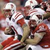 Nebraska quarterback Taylor Martinez is sacked by Wisconsin defensive lineman Tyler Dippel (51) during the first half of the Big Ten championship NCAA college football game Saturday, Dec. 1, 2012, in Indianapolis. (AP Photo/Michael Conroy)
