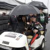 Photo - Kurt Busch drives a cart back to the garage area under an umbrella as rain halted practice for the Indianapolis 500 IndyCar auto race at the Indianapolis Motor Speedway in Indianapolis, Tuesday, May 13, 2014. (AP Photo)