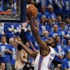 Oklahoma City\'s James Harden (13) takes the ball to the hoop against San Antonio\'s Tiago Splitter (22) as Oklahoma City\'s Serge Ibaka (9) looks on during Game 3 of the Western Conference Finals between the Oklahoma City Thunder and the San Antonio Spurs in the NBA playoffs at the Chesapeake Energy Arena in Oklahoma City, Thursday, May 31, 2012. Oklahoma City won, 102-82. Photo by Nate Billings, The Oklahoman