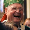 Cardinal Timothy Dolan, laughs following Mass, Sunday, Sept. 22, 2013, at St. Patrick\'s Cathedral in New York. Pope Francis\' said Sept. 19, that pastors should focus less on divisive social issues and should emphasize compassion over condemnation. Dolan told reporters that Francis,