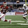 Oklahoma\'s Kenny Stills (4) makes a catch in front of Texas A&M\'s Dustin Harris (22) during the college football Cotton Bowl game between the University of Oklahoma Sooners (OU) and Texas A&M University Aggies (TXAM) at Cowboy\'s Stadium on Friday Jan. 4, 2013, in Arlington, Tx. Photo by Chris Landsberger, The Oklahoman