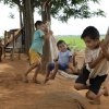 """In this Nov. 7, 2012 photo, the children of landless farmers play on a hammock where soy, right, grows on the disputed Campo Morumbi ranch, the site of deadly clashes between landless farmers and police, near the Marina Cue settlement, near Curuguaty, Paraguay. The """"Massacre of Curuguaty"""" on June 15 occurred when negotiations between farmers occupying a rich politician\'s land ended with a barrage of bullets that killed 11 farmers and 6 police officers. The underlying dispute that set up the clash was decades in the making. The area\'s poor residents have long alleged that the land was effectively stolen from the state by Sen. Blas Riquelme, a leader of the Colorado Party that backed dictator Alfredo Stroessner from 1954 to 1989, and has dominated the nation\'s politics ever since. (AP Photo/Jorge Saenz)"""