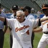 FILE - In this Saturday, June 26, 2010 file photo, former Baltimore Orioles manager Earl Weaver (4) waves to the crowd after taking the lineup card out before the start of a baseball game between the Orioles and Washington Nationals, in Baltimore, as members of the Orioles\' 1970 team were honored before the start of the game. At right is interim manager Juan Samuel (11). Weaver, the fiery Hall of Fame manager who won 1,480 games with the Baltimore Orioles, has died, the team announced Saturday, Jan. 19, 2013. He was 82. (AP Photo/Rob Carr, File)
