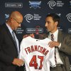 Photo -   Cleveland Indians general manager Chris Antonetti, right, presents new manager Terry Francona with a baseball jersey during a news conference at Progressive Field, Monday, Oct. 8, 2012. (AP Photo/David Richard)