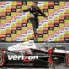 FILE - In this April 29, 2012 file photo, IndyCar driver Will Power, of Australia, jumps off his car at the winner\'s podium as he celebrates winning the the IndyCar Sao Paulo 300 in Sao Paulo, Brazil. On the one-year anniversary of his last victory, Power heads back to Brazil for the Sao Paulo 300, a race he has won every time since it was added to the calendar in 2010. (AP Photo/Andre Penner, File)
