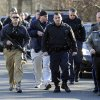Law enforcement canvass the area following a shooting at the Sandy Hook Elementary School in Newtown, Conn., about 60 miles (96 kilometers) northeast of New York City, Friday, Dec. 14, 2012. An official with knowledge of Friday\'s shooting said 27 people were dead, including 18 children. (AP Photo/Jessica Hill)