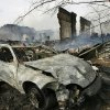 A car parked behind the businesses was destroyed in fire, also. Firefighters from eight communities assisted fire crews from Weleetka battle a large blaze that destroyed a block of downtown businesses. The fire ruined a floral shop, a popular restaurant and an embroidery store.on Main Street in Weleetka Friday, March 6, 2009. This photo was taken from the extended bucket of an Okmulgee Fire Department snorkel truck. BY JIM BECKEL, THE OKLAHOMAN