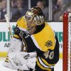 Photo - Boston Bruins goalie Tuukka Rask makes a save against the Detroit Red Wings during the first period of Game 2 of a first-round NHL hockey playoff series in Boston Sunday, April 20, 2014. (AP Photo/Winslow Townson)