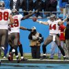 Photo -   Tampa Bay Buccaneers' Dallas Clark (44) reacts after his game-winning touchdown catch against the Carolina Panthers in overtime of an NFL football game in Charlotte, N.C., Sunday, Nov. 18, 2012. Tampa won 27-21. (AP Photo/Chuck Burton)