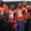 Photo - OSU players Dez Bryant (1), Kendall Hunter (24), Perrish Cox (16) and Jermiah Price (97) stand together on the sidelines before the college football game between the Oklahoma State University Cowboys (OSU) and the Grambling State University Tigers (GSU) at Boone Pickens Stadium in Stillwater, Okla., Saturday, September 26, 2009. Photo by Nate Billings, The Oklahoman ORG XMIT: KOD