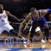 New York\'s J.R. Smith saves a ball as Oklahoma City\'s Reggie Jackson (15) looks on during NBA basketball game between the Oklahoma City Thunder and the New York Knicks at the Chesapeake Energy Arena, Sunday, April 7, 2010, in Oklahoma City. Photo by Sarah Phipps, The Oklahoman