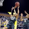Photo - Michigan State's Aerial Powers (23) is fouled as she drives to the basket against Michigan during the first half of an NCAA college basketball game in Ann Arbor, Mich., Sunday, Jan. 12, 2014. (AP Photo/Lon Horwedel)