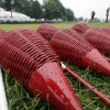 Rain drops cover wicker baskets near the putting green after a weather delay during the first round of the U.S. Open golf tournament at Merion Golf Club, Thursday, June 13, 2013, in Ardmore, Pa. (AP Photo/Charlie Riedel)