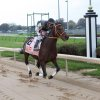 """Photo -  Jockey Calvin Borel (as himself) races Mine That Bird (Sunday Rest) at Churchill Downs in the movie """"50 to 1."""""""