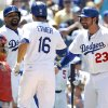 Photo - Los Angeles Dodgers' Andre Ethier (16) with St. Louis Cardinals catcher Yadier Molina, left, looking away, gets congratulations from Matt Kemp, second from left, and Adrian Gonzalez (23) after hitting a three-run home run in the fifth inning of a baseball game on Sunday, June 29, 2014, in Los Angeles. (AP Photo/Alex Gallardo)