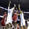 Photo - NCAA TOURNAMENT / COLLEGE BASKETBALL / ELITE 8 / UNIVERSITY OF OKLAHOMA / OU: Oklahoma's Willie Warren (13) tries to get off a shot through North Carolina's Ed Davis (32) and Wayne Ellington (22) during the first half in the Elite Eight game of NCAA Men's Basketball Regional between the University of North Carolina and the University of Oklahoma at the FedEx Forum on Sunday, March 29, 2009, in Memphis, Tenn.  PHOTO BY CHRIS LANDSBERGER, THE OKLAHOMAN  ORG XMIT: KOD