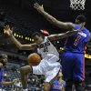 Milwaukee Bucks\' John Henson (31) loses the ball as he drives to the basket around Detroit Pistons\' Andre Drummond (1) during the second half of an NBA basketball game on Saturday, Oct. 13, 2012, in Milwaukee. The Bucks defeated the Pistons 108-91. (AP Photo/Jim Prisching)