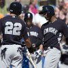 Photo - New York Yankees' Eduardo Nunez, right, is congratulated by Jacoby Ellsbury after hitting a two-run home run off Toronto Blue Jays' Todd Redmond during the third inning of an exhibition baseball game in Dunedin, Fla., on Sunday, March 2, 2014. (AP Photo/The Canadian Press, Frank Gunn)