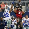 Tampa Bay Buccaneers wide receiver Vincent Jackson (83) pulls in a pass for a first down as Dallas Cowboys cornerback Orlando Scandrick (32) defends during the second half of an NFL football game on Sunday, Sept. 23, 2012, in Arlington, Texas. (AP Photo/Waco Tribune Herald/ Jose Yau)