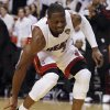 Photo -   Miami Heat shooting guard Dwyane Wade (3) puts his shoe back on during the first half at Game 5 of the NBA finals basketball series against the Oklahoma City Thunder, Thursday, June 21, 2012, in Miami. (AP Photo/Lynne Sladky)