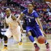 Photo -   Kentucky's A'dia Mathies (1) drives past Tennessee's Briana Bass (1) in the first half of an NCAA college basketball game on Monday, Feb. 13, 2012, in Knoxville, Tenn. (AP Photo/Wade Payne)