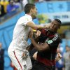 United States\' Clint Dempsey runs into Germany\'s Jerome Boateng during the group G World Cup soccer match between the USA and Germany at the Arena Pernambuco in Recife, Brazil, Thursday, June 26, 2014. (AP Photo/Ricardo Mazalan)