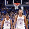 Oklahoma City\'s Russell Westbrook (0) and Thabo Sefolosha (2) react during Game 2 of the NBA Finals between the Oklahoma City Thunder and the Miami Heat at Chesapeake Energy Arena in Oklahoma City, Thursday, June 14, 2012. Photo by Sarah Phipps, The Oklahoman