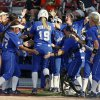 Kentucky\'s Lauren Cumbess celebrates with her team after hitting a home run in the fourth inning against La.-Lafayette during a Women\'s College World Series game between at ASA Hall of Fame Stadium in Oklahoma City Thursday, May 29, 2014. Photo by Bryan Terry, The Oklahoman