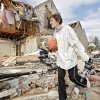 Hazel Wright gather items from the damage at her daughter\'s home in the Oak Tree addition on Wednesday, Feb. 11, 2009, after a tornado hit the area on Tuesday in Edmond, Okla. PHOTO BY CHRIS LANDSBERGER, THE OKLAHOMAN