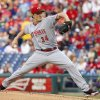 Photo - Cincinnati Reds starting pitcher Homer Bailey delivers during the first inning of a baseball game against the Philadelphia Phillies, Saturday, May 17, 2014, in Philadelphia. (AP Photo/Chris Szagola)