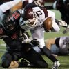 Westmoore\'s Chase Silva (32) brings down Jenks\' Tye Brett in high school football on Friday, Oct. 18, 2013 in Moore, Okla. Jenks retained possession. Photo by Steve Sisney, The Oklahoman