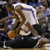 Oklahoma City\'s Kevin Durant (35) traps a loose ball from Sacramento\'s DeMarcus Cousins (15) during the NBA game between the Oklahoma City Thunder and the Sacramento Kings at the Chesapeake Energy Arena, Sunday, Jan. 19, 2014. Photo by Sarah Phipps, The Oklahoman