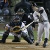 San Francisco Giants catcher Buster Posey hits a two-run home run during the sixth inning of Game 4 of baseball\'s World Series Sunday, Oct. 28, 2012, in Detroit. (AP Photo/Charlie Riedel)