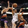 Boston Celtics guard Courtney Lee, center, drives between Phoenix Suns guard Goran Dragic, left, of Slovenia, and forward Markieff Morris, right, in the first half of an NBA basketball game, Friday, Feb. 22, 2013, in Phoenix. (AP Photo/Paul Connors)