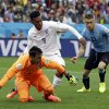 Photo - England's Daniel Sturridge, centre, battles for the ball with Uruguay's goalkeeper Fernando Muslera and Uruguay's Cristian Rodriguez during the group D World Cup soccer match between Uruguay and England at the Itaquerao Stadium in Sao Paulo, Brazil, Thursday, June 19, 2014.  (AP Photo/Matt Dunham)