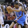 Photo - Oklahoma City Thunder guard Russell Westbrook runs into the defense of New Jersey Nets guard Keyon Dooling, rear, during the second quarter of an NBA basketball game Monday, Dec. 28, 2009, in East Rutherford, N.J. (AP Photo/Bill Kostroun) ORG XMIT: ERA102