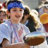Clayton Kinsey, eighth grade, practices his flip as students at All Saints Catholic School participate in a pancake breakfast and race on