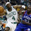 Photo - Boston Celtics' Jason Terry (4) drives past Philadelphia 76ers' Jason Richardson (23) in the first quarter of an NBA basketball game in Boston, Saturday, Dec. 8, 2012. (AP Photo/Michael Dwyer)