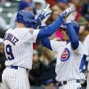 Photo - Chicago Cubs' Darwin Barney, right, is congratulated by teammate Nate Schierholtz after hitting two-run home run during the second inning of a baseball game against the Milwaukee Brewers on Friday, May 16, 2014, in Chicago. (AP Photo/Andrew A. Nelles)
