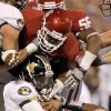 Oklahoma\'s Jamarkus McFarland (97) and Frank Alexander (84) bring down Missouri\'s James Franklin (1) during their game Saturday in Norman.Photo by Bryan Terry, The Oklahoman