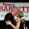 Photo -   Wisconsin Democratic gubernatorial candidate, Milwaukee Mayor Tom Barrett, kisses his wife Kris at his primary election victory party Tuesday, May 8, 2012, in Milwaukee. Democrats overwhelmingly picked Barrett to challenge Republican Wisconsin Gov. Scott Walker in a June recall election. (AP Photo/Morry Gash)